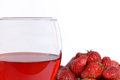 Strawberries and strawberry wine on white background Stock Photos