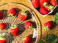 Strawberries on the table fresh in glass plate Stock Photos