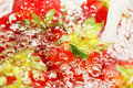Strawberries and water in bubbly abstract Stock Images