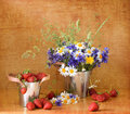 Strawberries and wild flowers Stock Images