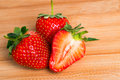 Strawberries on a wooden background Stock Images
