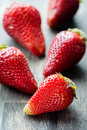 Strawberries on wooden table closeup selective focus Royalty Free Stock Image