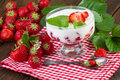 Strawberries yogurt with fresh fruits on red checkered napkin Royalty Free Stock Photo