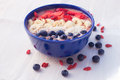 Strawberry banana smoothie bowl topped with strawberries bananas, coconut, blueberries and goji berries Royalty Free Stock Photo