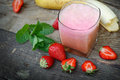 Strawberry- banana smoothie in glass (healthy drink, beverage) Royalty Free Stock Photo