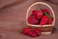 Strawberry in a basket Stock Images