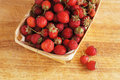 Strawberry in basket fresh red on wooden background Stock Photography