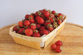 Strawberry in basket fresh red on wooden background Royalty Free Stock Image