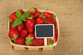 Strawberry in basket with price sign on canvas Royalty Free Stock Photo