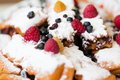 Strawberry blueberry roulade whipped powdered sugar closeup Stock Photography