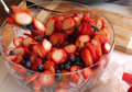 Strawberry and blueberry salad homemade in glass bowl Royalty Free Stock Photography