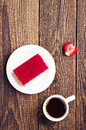 Strawberry cake and coffee background with cup of Stock Photography