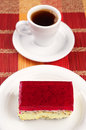 Strawberry cake and coffee with poppy cup of on colorful bamboo napkin Stock Image