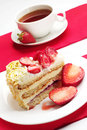 Strawberry cake and cup of tea piece Royalty Free Stock Photography