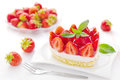 Strawberry cake small or piece with strawberries in the background Royalty Free Stock Photo