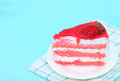 Strawberry Cake on white plate , blue table backgroud . Royalty Free Stock Photo