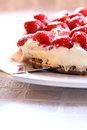 Strawberry cheesecake b photograph of a on a white plate Royalty Free Stock Photos
