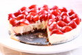 Strawberry cheesecake c photograph of a with a slice taken out Royalty Free Stock Photos