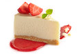 Strawberry cheesecake with fresh berries and sweet sauce Royalty Free Stock Photo