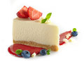 Strawberry cheesecake with fresh berries and sweet sauce Stock Images