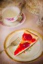 Strawberry cheesecake in setting in vintage style with texture Royalty Free Stock Photo