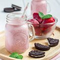 Strawberry cheesecake smoothie with cream cheese and milk, served with chocolate cookies, square Royalty Free Stock Photo