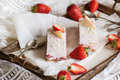 Strawberry cheesecake on vintage tray with silver spoons and fresh strawberrys Royalty Free Stock Images