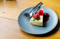 Strawberry cheesecake on wooden table with copyspace Stock Photography