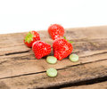 Strawberry chewing gum on wooden background Stock Image
