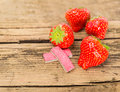 Strawberry chewing gum on wooden background Royalty Free Stock Photos