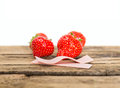 Strawberry chewing gum on a wooden background Stock Image