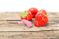 Strawberry chewing gum on a wooden background Stock Photography