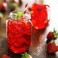 Strawberry cocktail close up in jar with deep red color Royalty Free Stock Photos