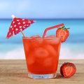 Strawberry cocktail drink on the beach and sea in summer Royalty Free Stock Photo