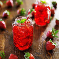 Strawberry cocktail in jar with deep red color Royalty Free Stock Photography