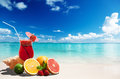 Strawberry cocktail and tropical fruit on the beach Stock Photography