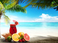 Strawberry cocktail and tropical fruit on the beach Stock Images