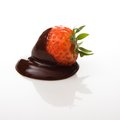 Strawberry covered in dark chocolate Royalty Free Stock Photo