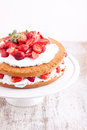 Strawberry cream cake on a white background Stock Images