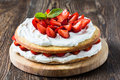 Strawberry cream layer cake homemade fresh colorful and delicious dessert with juicy strawberries and sweet whipped Stock Photo