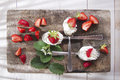 Strawberry with cream presentation of the strawberries spoons on various Royalty Free Stock Photos