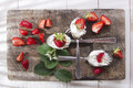 Strawberry with cream presentation of the strawberries spoons on various Stock Images