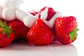 Strawberry with cream on white reflexive background isolated Stock Photo