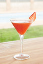 Strawberry daiquiri cocktail by a pool outdoors Royalty Free Stock Photo