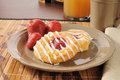 Strawberry danish rolls with unfiltered apple juice and coffee Royalty Free Stock Image