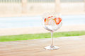 Strawberry gin and tonic cocktail by a pool outdoors Royalty Free Stock Photo