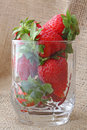 Strawberry in a glass over woven fabric Royalty Free Stock Photo