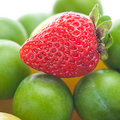 Strawberry, green and yellow plum Royalty Free Stock Photography