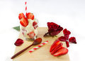 Strawberry ice cream rose flower and spoon on wooden board side view Stock Photo