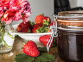 Strawberry jam fresh bio strawberries and on the table Royalty Free Stock Photos